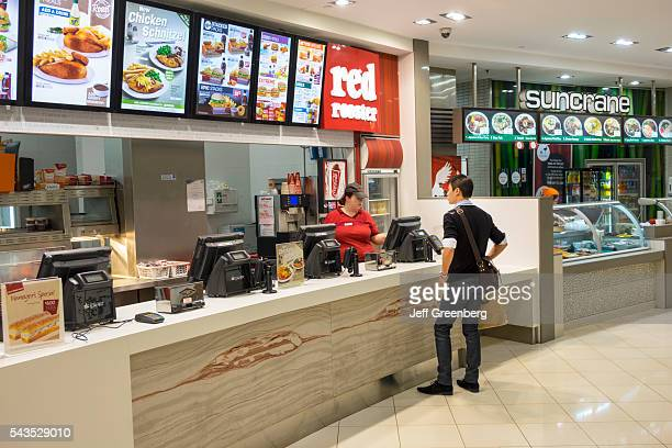 Australia Queensland Brisbane Central Business District Queen Street Mall food court Red Rooster fast food restaurant counter customer