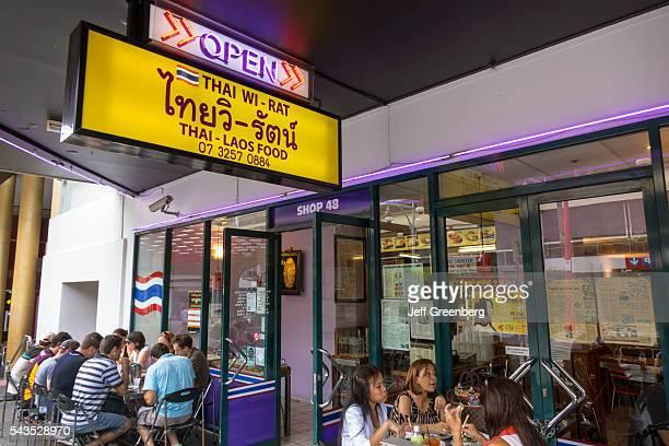 Australia Queensland Brisbane Fortitude Valley Chinatown Thai WiRat Thai Laos food restaurant Asian man woman tables alfresco dining sign front...