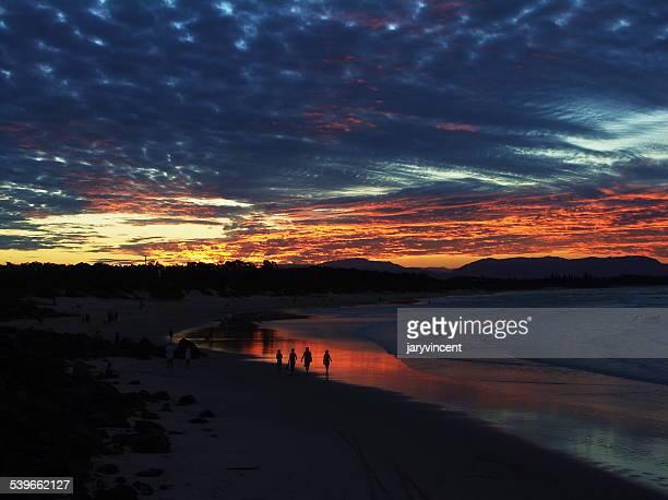 Australia, Queensland, Brisbane, Sandy beach and sunset reflections in water