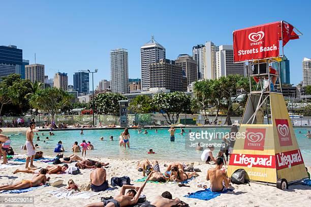 Australia Queensland Brisbane Southbank Parklands Streets Beach sunbathers sand water Central Business District CBD city skyline skyscrapers buildings