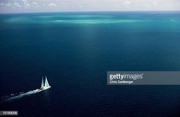 Australia, Queensland, Great Barrier Reef, ship sailing across water,