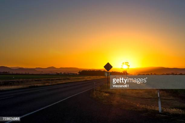 Australia, Queensland, landscape near Mackay, road at sunset