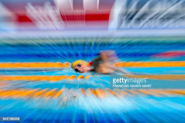 Australia 's Ariarne Titmus competes during the swimming women's 800m freestyle qualifications during the 2018 Gold Coast Commonwealth Games at the...