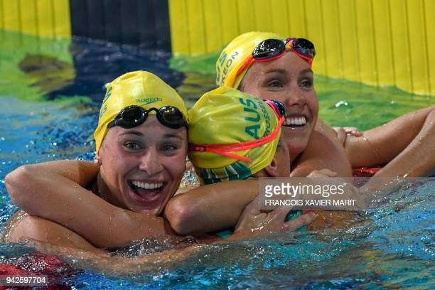 Australia 's Emma McKeon Australia's Madeline Groves and Australia 's Brianna Throssell celebrate after the swimming women's 100m butterfly final...
