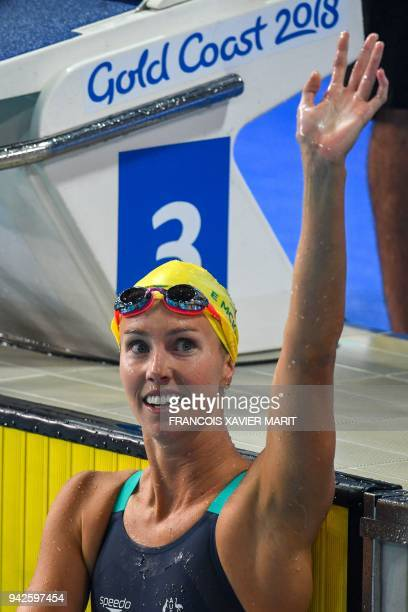 Australia 's Emma McKeon wins the swimming women's 100m butterfly final during the 2018 Gold Coast Commonwealth Games at the Optus Aquatic Centre in...