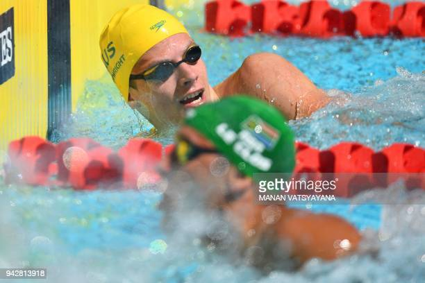 Australia 's Jack Cartwright and South Africa 's Chad Le Clos during the swimming men's 100m freestyle qualifications during the 2018 Gold Coast...