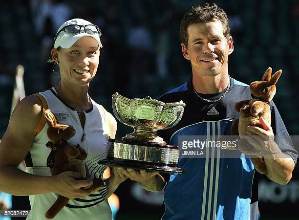 Scott Draper and Samantha Stosur of Australia hold the winner's trophy following their victory in their mixed doubles final at the 2005 Australian...
