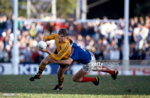 Australia scrum-half Nick Farr-Jones is tackled by Eric Champ of France during the Rugby Union World Cup Semi-final held in Sydney on 13th June 1987....
