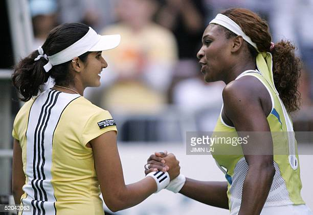 Seventh seed Serena Williams of the US shakes hands with Sania Mirza of India at the end of their women's singles third round match at the 2005...