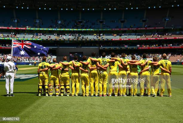 Australia stand as a team for the national anthem during game one of the One Day International Series between Australia and England at Melbourne...