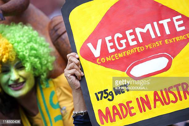 Australia supporters cheer with a placard reading 'vegemite' prior to the Group D match of the FIFA women's football World Cup Australia vs Norway on...