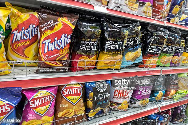 Australia Sydney Central Business District CBD convenience store shelves food junk snack potato chips bags competing brands packaging sale retail...
