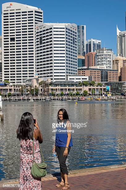 Australia Sydney Central Business District CBD Darling Harbor Cockle Bay Promenade Wharf water skyscrapers city skyline Asian woman friends posing...