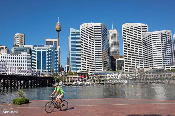 Australia Sydney Central Business District CBD Darling Harbor Cockle Bay Promenade Wharf water skyscrapers city skyline man bicycle biker biking...
