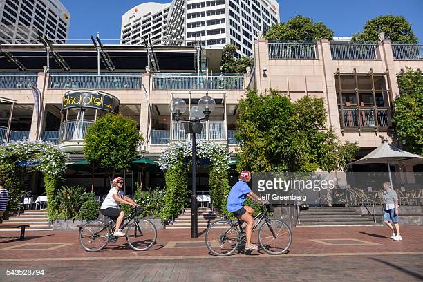 Australia Sydney Central Business District CBD Darling Harbor Cockle Bay Promenade Wharf woman bicycle biking riding