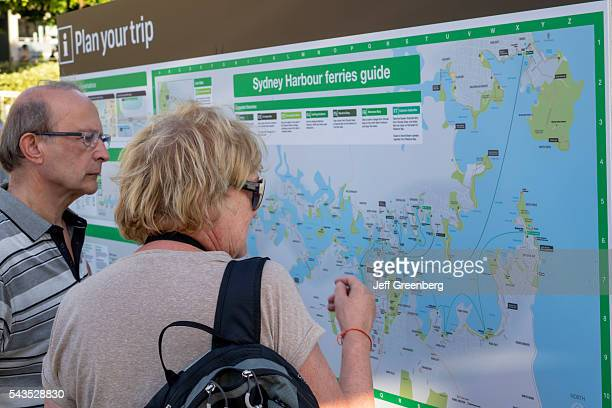 Australia Sydney Central Business District CBD Darling Harbor Passenger Terminal man woman couple Ferries route map looking