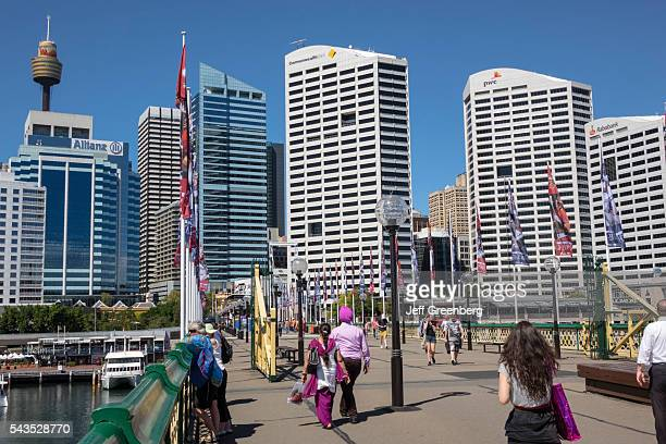 Australia Sydney Central Business District CBD Darling Harbor Pyrmont Bridge pedestrian walking Cockle Bay skyscrapers city skyline Sydney Tower