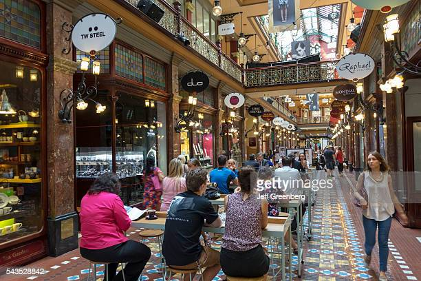 Australia Sydney Central Business District CBD George Street The Strand Arcade shopping historic inside interior tables dining restaurant cafe man...