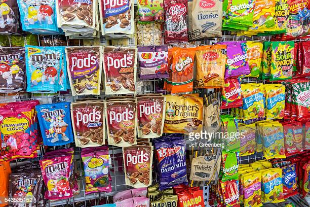 Australia Sydney Haymarket EzyMart convenience store snacks junk food display sale candy chocolate bags competing brands packaging
