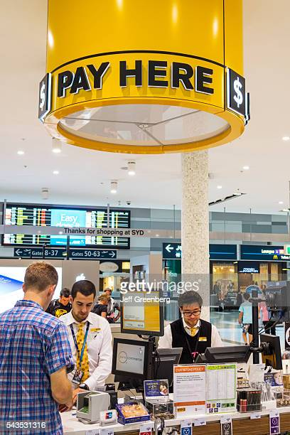 Australia Sydney KingsfordSmith Airport SYD inside interior terminal concourse gate area shopping checkout cashier customer paying purchasing sign...