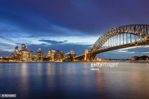 australia sydney skyline with sydney harbour bridge at twilight - darling harbour stock pictures, royalty-free photos & images