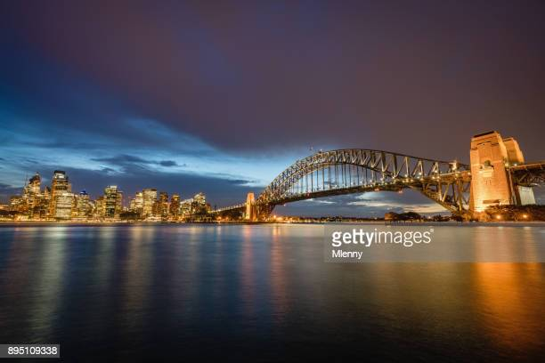 australia sydney skyline with sydney harbour bridge at twilight - mlenny stock pictures, royalty-free photos & images