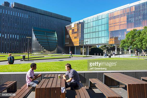 Australia, Sydney, University of Sydney education campus student Black man teen New Law Building glass Fisher Library.