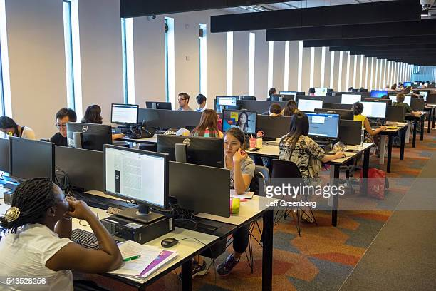 Australia Sydney University of Sydney education campus student Fisher Library Black girl woman teen Asian computer stations screen monitor lab...