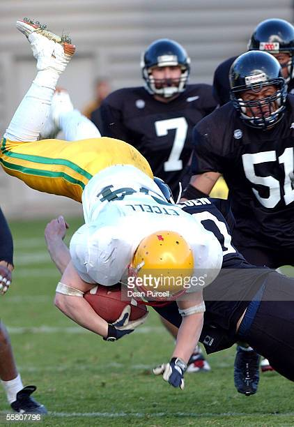 Australia Tail back Stuart Etcell gets taken out by NZ Cornerback Chance Deluen during the American Football match between the New Zealand Iron...