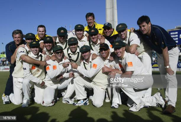 Australia team celebrate with a replica urn after winning the match to retain The Ashes with an unbeatable 3 0 lead in the series on day three of the...