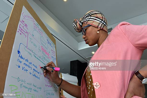 Australia technology attacks summit diplomacy by GLENDA This photo taken on June 11 2015 shows team member Yassmin AbdelMagied working on a project...
