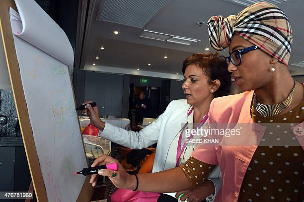 Australia technology attacks summit diplomacy by GLENDA This photo taken on June 11 2015 shows team members Anne Aly and Yassmin AbdelMagied working...