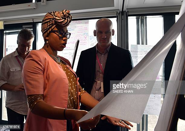 Australia technology attacks summit diplomacy by GLENDA This photo taken on June 11 2015 shows team members Yassmin AbdelMagied and Matthew Quinn...
