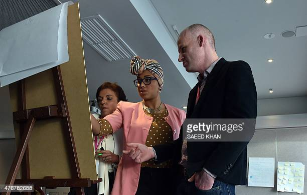 Australia technology attacks summit diplomacy by GLENDA This photo taken on June 11 2015 shows team members Anne Aly Yassmin AbdelMagied and Matthew...