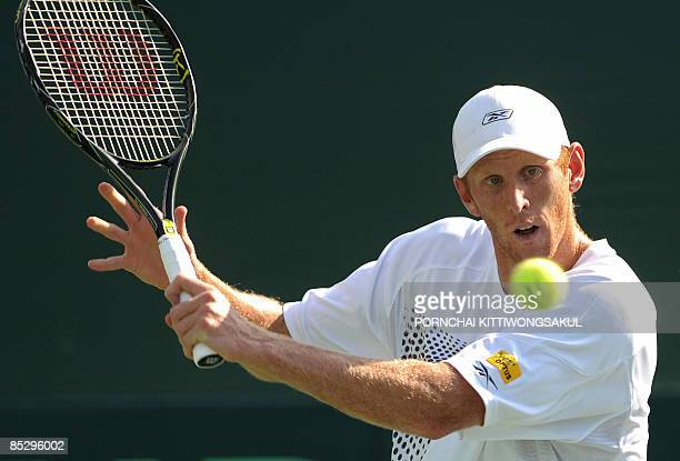 Australia tennis player Chris Guccione views the ball as he returns to Kittipong Wachiramanowong of Thailand during the Davis Cup Asia/Oceania Zone...