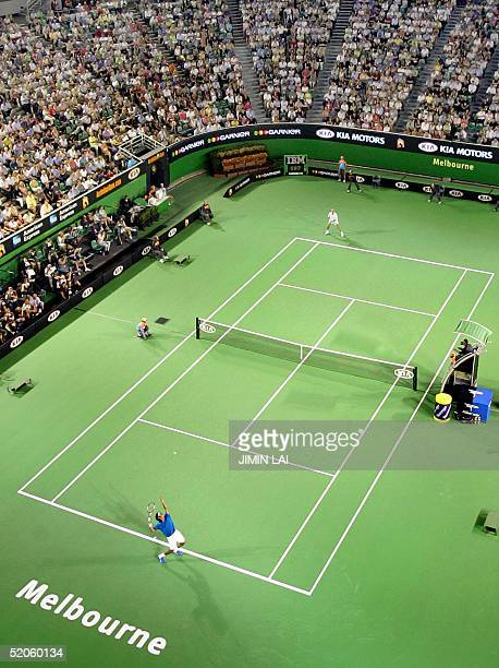 This general view shows top seed Roger Federer of Switzerland serving against eighth seed Andre Agassi of the US at the Rod Laver Arena in their...