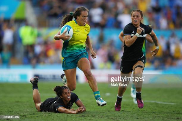 Australia Vani Pelite makes a break in the Women's Gold Medal Rugby Sevens Match between Australia and New Zealand on day 11 of the Gold Coast 2018...