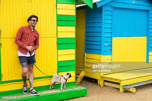 Australia Victoria Melbourne Brighton Beach bathing boxes huts cabins colorful man dog leash pet pug
