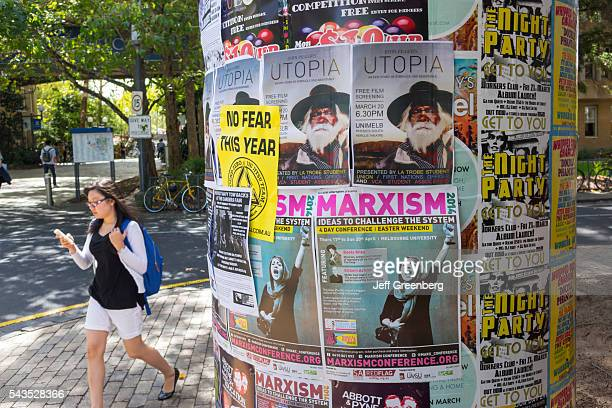 Australia Victoria Melbourne Carlton Parkville University of Melbourne campus school kiosk notices bulletin board Marxism conference Asian woman...