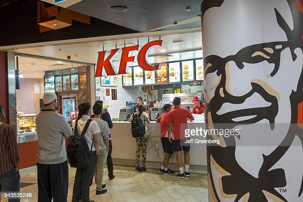 Australia Victoria Melbourne Central Business District CBD Central Station KFC fast food restaurant tables customers line queue queuing Colonel...