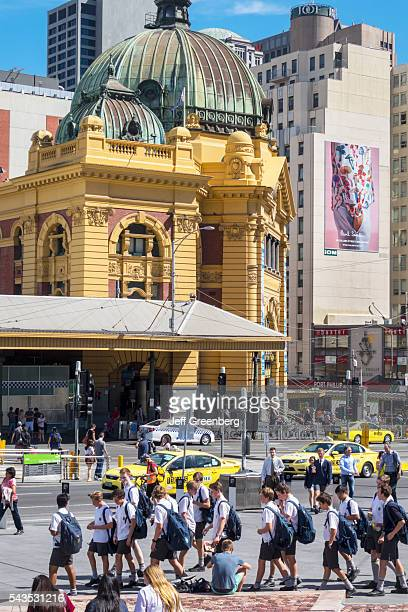 Australia Victoria Melbourne Central Business District CBD Flinders Street Station view from Federation Square pedestrians traffic dome city skyline...