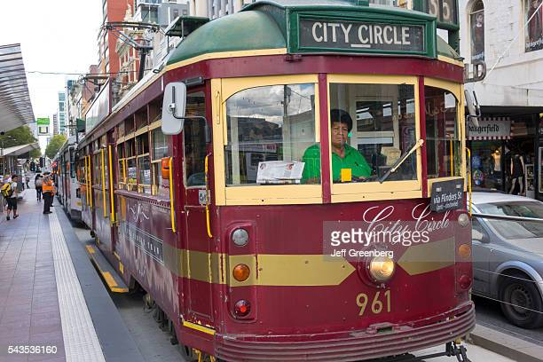Australia Victoria Melbourne Central Business District CBD Yarra Trams tram trolley tramway public transportation City Circle Route Black woman...