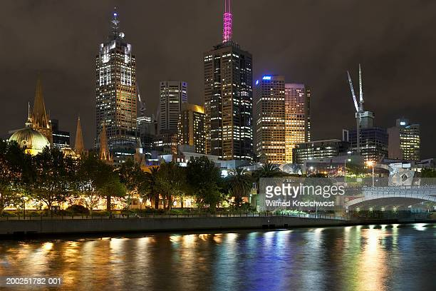 Australia, Victoria, Melbourne city skyline and Yarra River, night