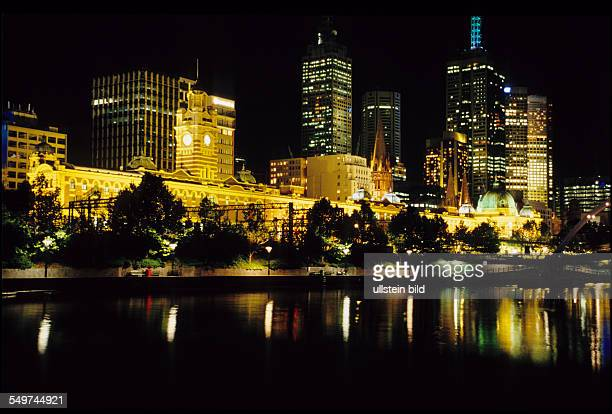 Australia, view from Yarra River to Flinders Station at night, second-biggest City of Australia