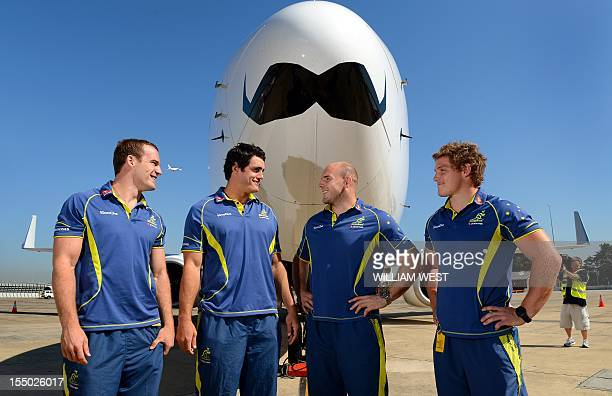Australia Wallabies rugby union players Pat McCabe Dave Dennis Stephen Moore and Michael Hooper stand in front of a Qantas 737 with a giant moustache...