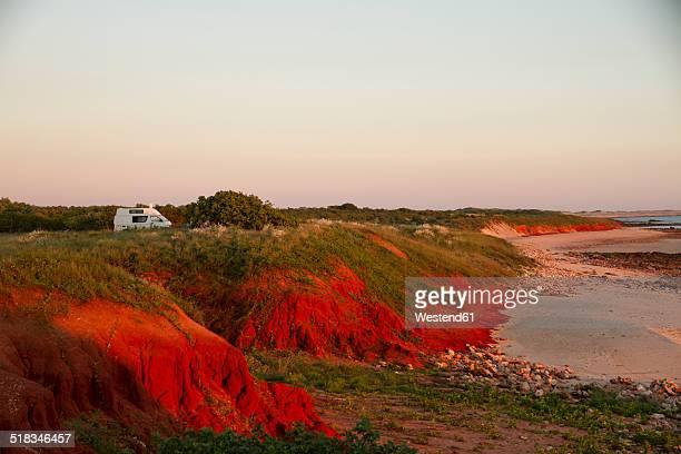 Australia, Western Australia, Camper van on beach near Broome at sunset