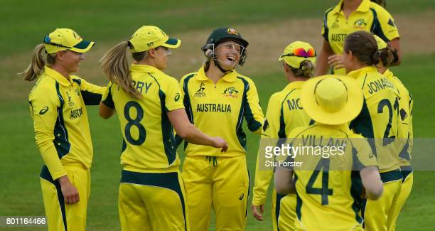 Australia wicketkeeper Aliyssa Healy shares a joke with team mates after running out West Indies batsman Anisa Mohammed during the ICC Women's World...