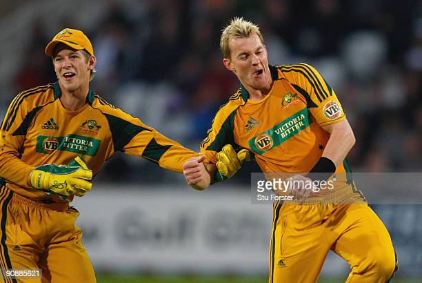 Australia wicketkeeper Tim Paine and bowler Brett Lee celebrate the wicket of Andrew Strauss during the 6th NatWest ODI between England and Australia...