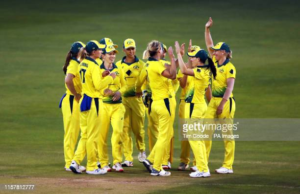 Australia Women players celebrate taking the wicket of England Women's Tammy Beaumont during the Ashes T20 at The Cloudfm County Ground, Chelmsford.