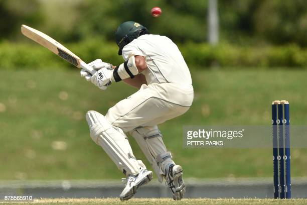 Australia XI's batsman Jason Sangha avoids a bouncer from England's pace bowler Chris Woakes on the fourth and final day of a four-day Ashes tour...